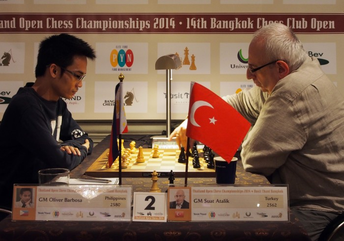 GM Oliver Barbosa and GM Suat Atalik at the Bangkok Chess Club Open 2014