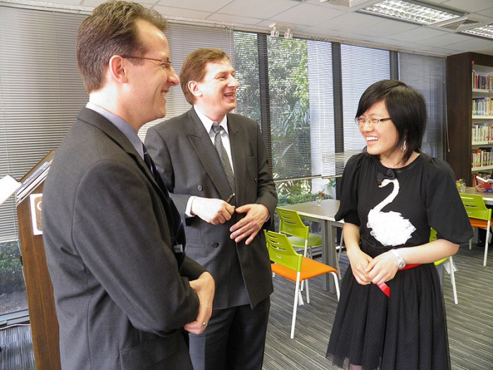 GM Hou Yifan with Dr. Alexander Klemm and Kai Tuorila